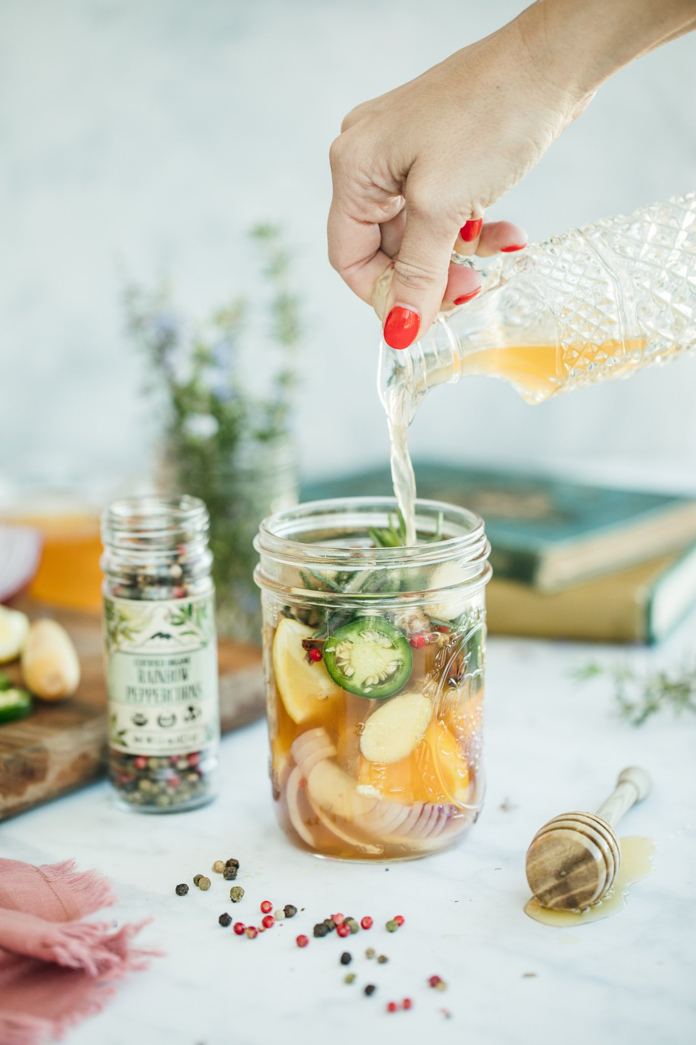 fire cider herbal remedy with mason jar and herbs
