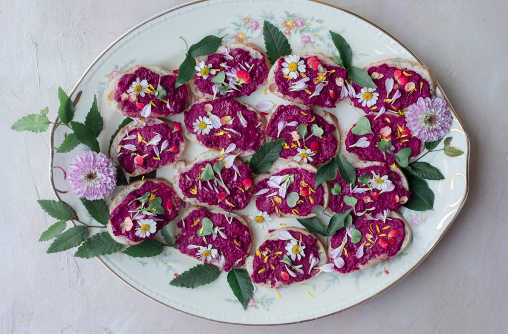 beet crostini with edible flower confetti
